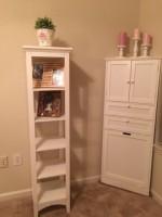 white slim book shelf
