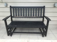 Black wood outdoor rocking bench