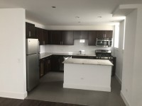 Spacious bedroom in 2BR apt; modern kitchen; in-unit laundry